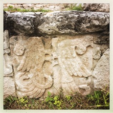 There are few masks and carved reliefs and glyphs. This pair of parrots caught my eye.